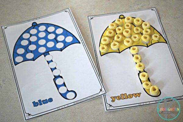 Kids will practice one to one correspondence by putting the correct color fruit loop on the umbrella spots.