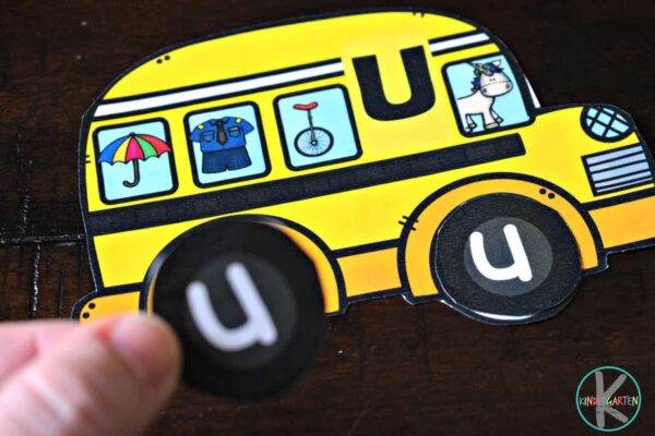 Help kids practicing identifying uppercase and lowercase letters in this school bus literacy activity