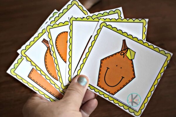 this pumpkin themed math game is a fun way for kindergartners to learn about shapes for kids