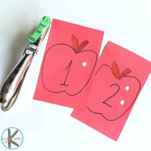 hole punching math activity using apple with worm