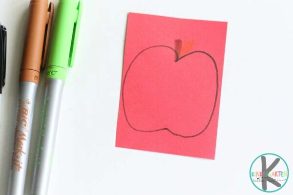 draw an apple shape on a piece of red construction paper