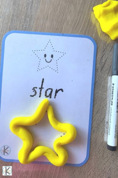 12 free shape mats to learn shapes - featured is a star using yellow playdough