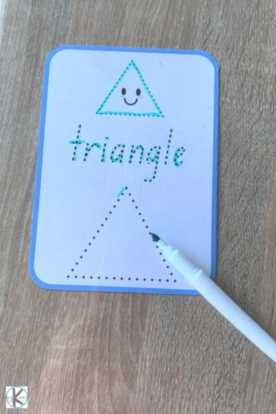 use a crayon, pencil, marker, or dry erase marker to practice tracing shapes and shape names with this shape printable for pre k, kindergarten, and first grade students - shown is a triangle
