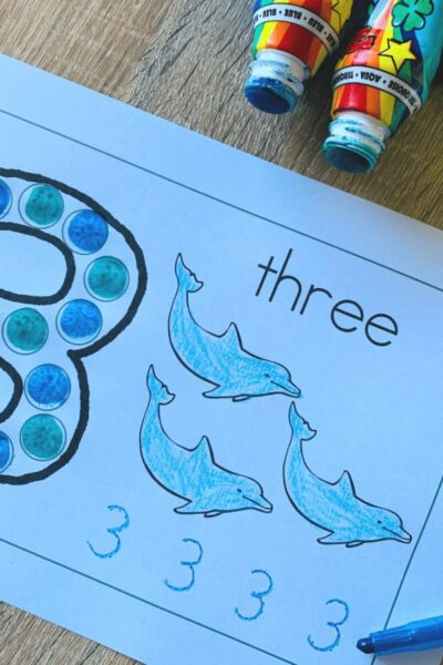 use bingo markers to make the number three; now count and color the dolphins