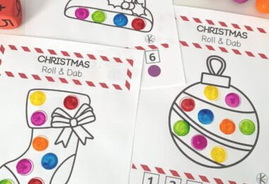 These super cute, free printable Christmas worksheets are a fun way for toddler, preschool, pre-k, and kindergarten age students to work on number recognition and color recognition! These Christmas Roll and Dot Christmas worksheets for preschool use bingo markers for an educational do a dot printables to celebrate the holiday season in December.