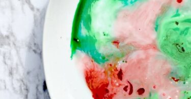 Magic Milk Experiment with a festive flair perfect for making learning fun in December. This Christmas Science experiment for toddler, preschool, pre-k, kindergarten, and first grade students is so easy and fun to watch - it does not disappoint!