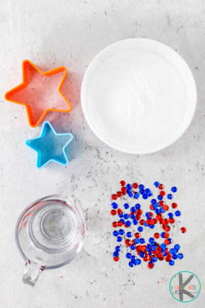 To try this cuteindependence day activity you will need a few simple materials you probably already have on hand in your kitchen: 1-2 boxes baking soda (depending on the size and number of stars you want to make) vinegar water clear dish soap (optional) star cookie cutter (optional) glitter(optional, but magical to make the stars burst) food coloring (we used red and blue, but this is optional) bowl and spoon to mix it up tray or rectangular pan squirt bottle, eyedropper, or baster
