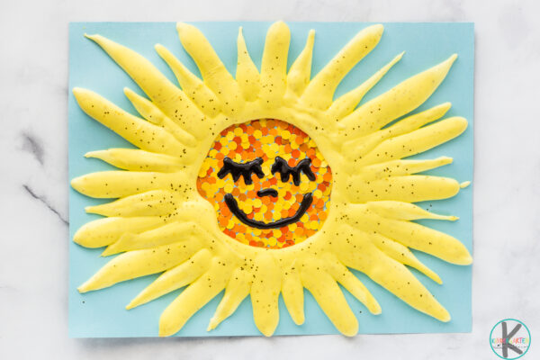happy puffy paint sun craft with paint chip dots