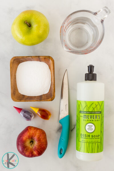 1/4 cup baking soda (give or take) 2 squirts dish soap 1/4 cup distilled white vinegar pipette or dropper (optional) food coloring (optional) apple (s) sharp knife plate with lip